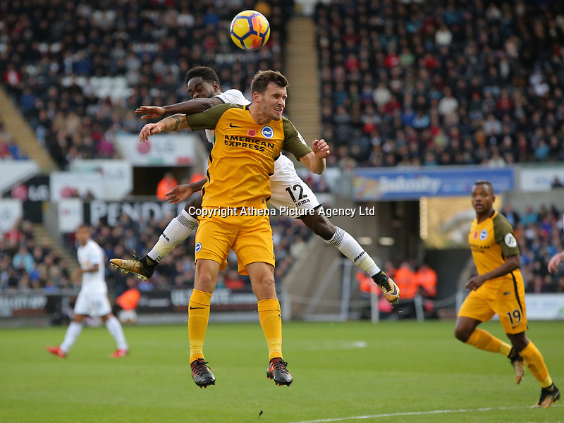 Nathan Dyer of Swansea City battles for a header against Pascal Gross of Brighton during the Premier League match between Swansea City and Brighton and Hove Albion at The Liberty Stadium, Swansea, Wales, UK. Saturday 04 November 2017