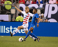 PHILADELPHIA, PA - JUNE 30: Tim Ream #13 challenges Gevaro Nepomuceno #11 for the ball during a game between Curacao and USMNT at Lincoln Financial Field on June 30, 2019 in Philadelphia, Pennsylvania.