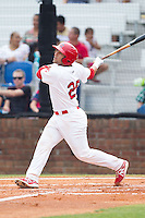 Jose Godoy (25) of the Johnson City Cardinals follows through on his swing against the Elizabethton Twins at Cardinal Park on July 27, 2014 in Johnson City, Tennessee.  The game was suspended in the top of the 5th inning with the Twins leading the Cardinals 7-6.  (Brian Westerholt/Four Seam Images)