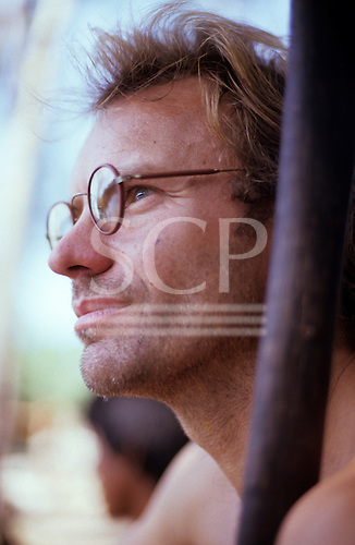 Pavuru Village, Brazil. Sting in the Amazon wearing glasses; Indian village, Xingu Indigenous area, Nov 1990.