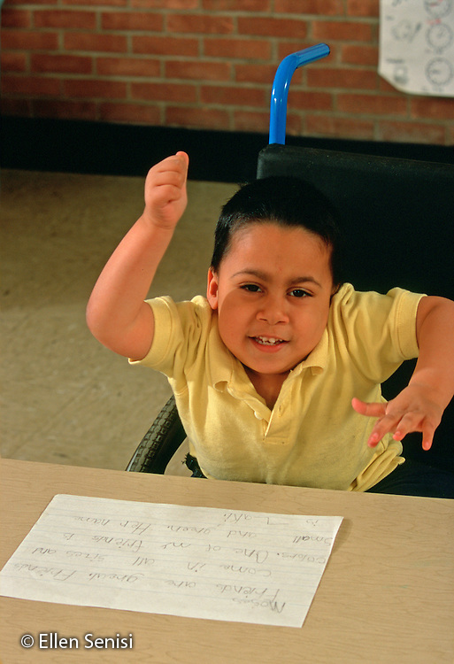 MR/ Schenectady, New York.Zoller Public School-Inclusion Class / Grade 1.Boy (7, Bangledeshi and Puerto-Rican-American) is happy his writing assignment is done..MR:Rah1      FC#:20332-00420.scan from slide.© Ellen B. Senisi
