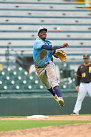 FCL Rays third baseman Alejandro Pie (64) throws to first base during a game against the FCL Pirates Gold on July 26, 2021 at LECOM Park in Bradenton, Florida. (Mike Janes/Four Seam Images)