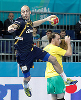 Spain's Albert Rocas (l) and Australia's Mitchell Hedges during 23rd Men's Handball World Championship preliminary round match.January 15,2013. (ALTERPHOTOS/Acero) /NortePhoto