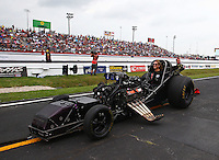 Apr 27, 2014; Baytown, TX, USA; The chassis for the car of NHRA funny car driver Jack Beckman is towed back to the pits without the body during the Spring Nationals at Royal Purple Raceway. Mandatory Credit: Mark J. Rebilas-orts