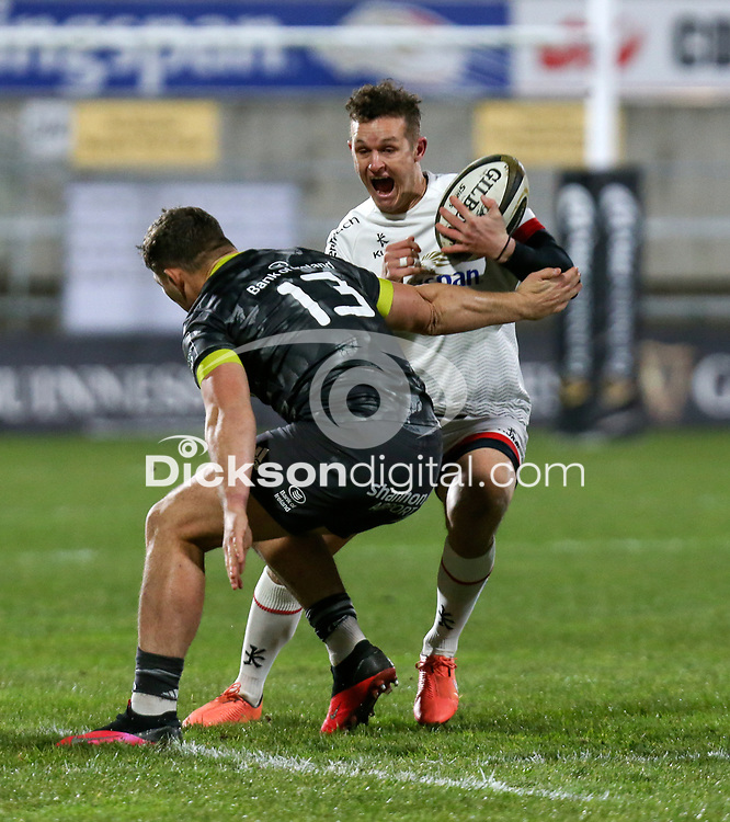 2nd January 2021 | Ulster vs Munster <br /> <br /> Billy Burns is tackled by Dan Goggin during the PRO14 Round 10 clash between Ulster Rugby and Munster Rugby at the Kingspan Stadium, Ravenhill Park, Belfast, Northern Ireland. Photo by John Dickson/Dicksondigital