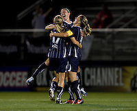 Cat Whitehill (4) of the Washington Freedom celebrates a goal with teammates Sarah Huffman (14) and Nikki Marshall (17)  during their game at the Maryland SoccerPlex in Boyds, Maryland.  The Washington Freedom defeated the Philadelphia Independence, 2-0.