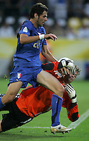 Italian midfielder (20) Simone Perrotta knocks the ball out of the hands of German goalkeeper (1) Jens Lehmann.  Italy defeated Germany, 2-0, in overtime in their FIFA World Cup semifinal match at FIFA World Cup Stadium in Dortmund, Germany, July 4, 2006.