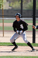 Trayce Thompson #14 of the Chicago White Sox hits a homerun in a minor league spring training game against the Cleveland Indians at the White Sox complex on March 24, 2011 in Glendale, Arizona. .Photo by:  Bill Mitchell/Four Seam Images.
