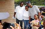 Actor/Comedian Chris Rock has his photo taken with Hurricane Katrina evacuees Jarmal and Myra McNeil and their daughter Jarlai Morris while on a visit to the Bonita House in Houston,Texas Thursday Sept. 29,2005.