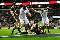 Mike Brown of England celebrates as Chris Ashton of England scores a try during the RBS 6 Nations match between England and Scotland at Twickenham on Saturday 02 February 2013 (Photo by Rob Munro)