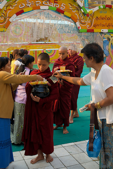 Monks collecting their Aims at the Maha Muni during Full Moon Festival, Mandalay,  Myanmar, Burma,