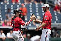 Louisville Cardinals pitcher Michael Kirian (33) celebrates with catcher Henry Davis (32) after closing out Game 7 of the NCAA College World Series against the Auburn Tigers on June 18, 2019 at TD Ameritrade Park in Omaha, Nebraska. Louisville defeated Auburn 5-3. (Andrew Woolley/Four Seam Images)