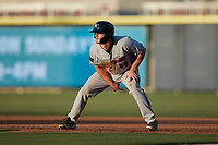 Luke Berryhill (36) of the Fayetteville Woodpeckers takes his lead off of first base against the Kannapolis Cannon Ballers at Atrium Health Ballpark on June 22, 2021 in Kannapolis, North Carolina. (Brian Westerholt/Four Seam Images)