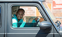 20th May 2020, Melwood Training ground, Liverpool, England;  Liverpools Fabinho leaves Melwood in Liverpool after training on May 20, 2020. The Premier League clubs are allowed to start small-group training from Tuesday after the top-flight football league in England was suspended on March 13 due to coronavirus outbreak.