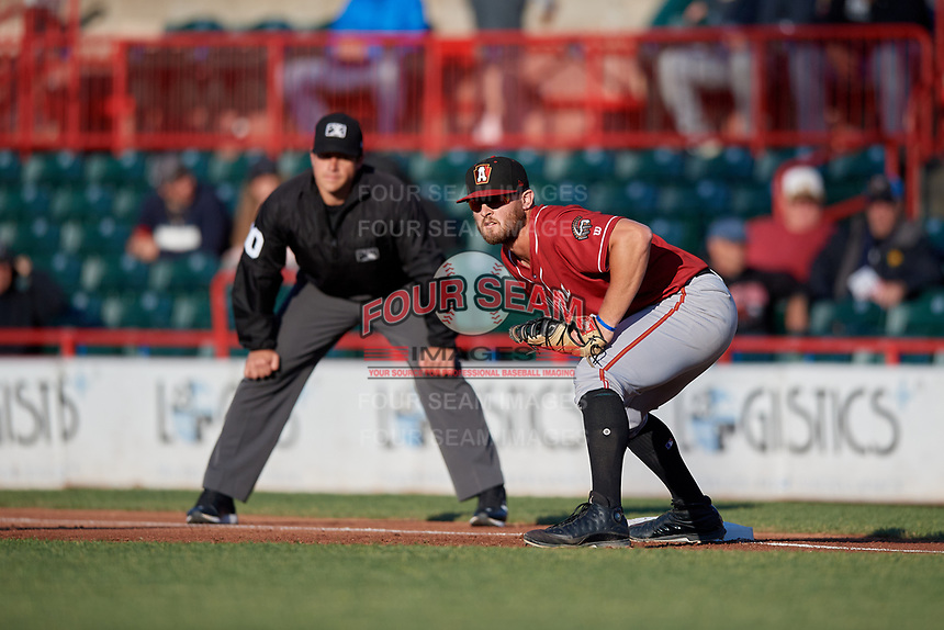 Altoona Curve first baseman Jerrick Suiter (31) holds a runner on as umpire Mike Savakinas looks on during an Eastern League game against the Erie SeaWolves on June 3, 2019 at UPMC Park in Erie, Pennsylvania.  Altoona defeated Erie 9-8.  (Mike Janes/Four Seam Images)