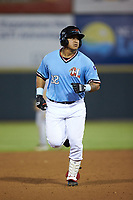 Melvin Novoa (32) of the Hickory Crawdads rounds the bases after hitting a home run against the Charleston RiverDogs at L.P. Frans Stadium on August 10, 2019 in Hickory, North Carolina. The RiverDogs defeated the Crawdads 10-9. (Brian Westerholt/Four Seam Images)