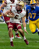 Boston College quarterback Dennis Grossel (6) gets pursued by Pitt defensive tackle Jaylen Twyman (97). The Boston College Eagles defeated the Pitt Panthers 26-19 in the football game played at Heinz Field, Pittsburgh Pennsylvania on November 30, 2019.