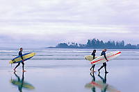 Long Beach, Pacific Rim National Park Reserve, Vancouver Island, BC, British Columbia, Canada - Surfers carrying Surf Boards on Beach