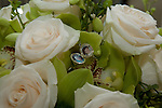 Kelly has included a photo locket in her bouquet in rememberance of her loved ones.