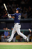 Mobile BayBears first baseman Matt Thaiss (21) follows through on a swing during a game against the Jacksonville Jumbo Shrimp on April 14, 2018 at Baseball Grounds of Jacksonville in Jacksonville, Florida.  Mobile defeated Jacksonville 13-3.  (Mike Janes/Four Seam Images)