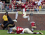 Senior wide receiver Kenny Shaw leaps over teammate Jesus Wilson when the #2 ranked Florida State Seminoles defeated the Idaho Vandals 80-14 at Doak S Campbell Stadium in Tallahassee, Florida