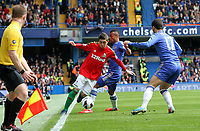 Pictured: Pablo Hernandez is forrced along the touch line by Ashley Cole<br /> Barclays Premier League, Chelsea FC (blue) V Swansea City,<br /> 28/04/13