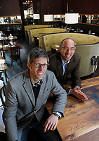 Alloy Workshop owners Zach Snider, left, and Dan Zimmerman show off the beautiful new space of the Commonwealth Restaurant & Skybar their firm recently designed and built on the Downtown Mall in Charlottesville, VA.  Photo/The daily Progress/Andrew Shurtleff.