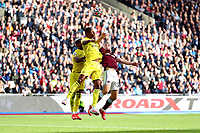 3rd October 2021;   City of London Stadium, London, England; EPL Premier League football, West Ham versus Brentford; Tomas Soucek of West Ham United competes for the ball with Ethan Pinnock of Brentford