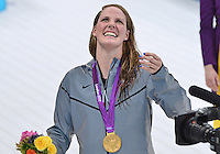 July 30, 2012..MISSY FRANKLIN of USA tries to catch a flag given by a fan in the stands after award ceremony of women's 100m backstroke event at the Aquatics Center on day three of 2012 Olympic Games England in London, United Kingdom...(Credit Image: © Mohammad Khursheed/Cal port Media)