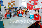 Derryquay NS students using interactive tablets in the class room with principal Ide Brosnan.
