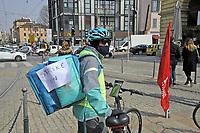 - Sciopero nazionale dei riders in bicicletta per la consegna a domicilio dei cibi e del personale dei corrieri espresso e della logistica, manifestazione a Milano, marzo 2021<br /> <br /> - National strike of home food delivery bike riders and of express couriers and logistic personnel, demonstration in Milan,  March 2021