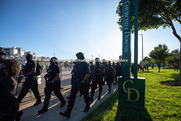 """September 5, 2020: Members of the NFAC march outside of Churchill Downs  the 146th Kentucky Derby. With the Kentucky Derby being the biggest sports event for the State of Kentucky, protestors have chosen the  event as a focal point for their calls for justice in the death of Breonna Taylor. Multiple groups from around the country have converged on Louisville to protest during the """"Run for the Roses"""" at Churchill Downs in Louisville. Michael Clubb/Eclipse Sportswire/CSM"""