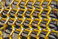 Cuxhafen Steel Construction GMBH: EUROPA, DEUTSCHLAND, NIEDERSACHSEN, CUXHAFEN (EUROPE, GERMANY), 16.06.2010: Industriegelaende zur Herstellung und Transport von Offshore Windkraft Anlagen, Cuxhafen Steel Construction GMBH, Gruendungsstrukturen fuer Offshore-Windenergieanlagen, Stahlbau, Dreibein, Fundamente, Spinne, Standsicherheit, gelb,