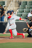 Scott Kingery (18) of the Lakewood BlueClaws follows through on his swing against the Kannapolis Intimidators at Intimidators Stadium on July 16, 2015 in Kannapolis, North Carolina.  The BlueClaws defeated the Intimidators 3-1.  (Brian Westerholt/Four Seam Images)