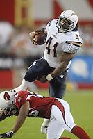 Aug 25, 2007; Glendale, AZ, USA; San Diego Chargers fullback Lorenzo Neal (41) leaps over an Arizona Cardinals defender in the first half at University of Phoenix Stadium. Mandatory Credit: Mark J. Rebilas-US PRESSWIRE Copyright © 2007 Mark J. Rebilas