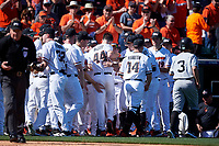 The Oregon State Beavers mob Alex McGarry (44) after hitting a home run during an NCAA game against the New Mexico Lobos at Surprise Stadium on February 14, 2020 in Surprise, Arizona. (Zachary Lucy / Four Seam Images)