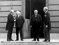 "The ""Big Four"" at the Paris Peace Conference in 1919, following the end of World War I.<br /> <br /> Council of Four at the WWI Paris peace conference, May 27, 1919 (candid photo) (L - R) Prime Minister David Lloyd George (Great Britian) Premier Vittorio Orlando, Italy, French Premier Georges Clemenceau, President Woodrow Wilson"