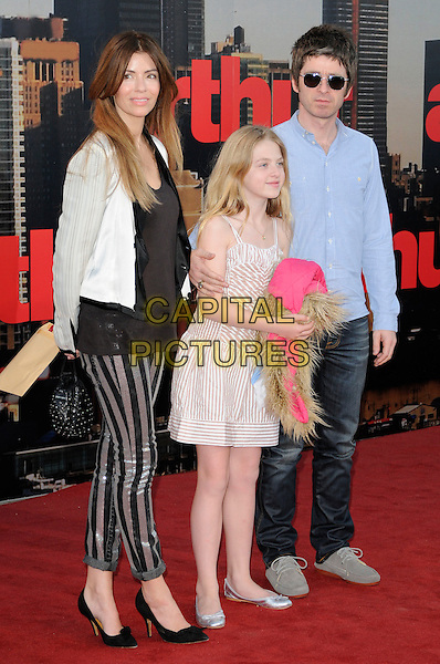 SARAH MacDONALD, ANAIS & NOEL GALLAGHER.European Premiere of 'Arthur' at Cineworld, O2 Arena, London, England, UK, April 19th 2011..full length black dress beige stripe leggings jacket blazer couple shirt jeans denim sunglasses shades mother mom mum daughter father dad family.CAP/CAN.©Can Nguyen/Capital Pictures.