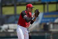 Hickory Crawdads starting pitcher Hans Crouse (10) looks to his catcher for the sign against the Greensboro Grasshoppers at L.P. Frans Stadium on May 26, 2019 in Hickory, North Carolina. The Crawdads defeated the Grasshoppers 10-8. (Brian Westerholt/Four Seam Images)