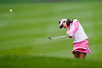 Yuting Shi of China hits her shot during the Hyundai China Ladies Open 2014 Pro-am on December 10 2014 at Mission Hills Shenzhen, in Shenzhen, China. Photo by Xaume Olleros / Power Sport Images