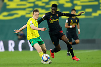 20th April 2021; Carrow Road, Norwich, Norfolk, England, English Football League Championship Football, Norwich versus Watford; Oliver Skipp of Norwich City under pressure from Ismaila Sarr of Watford