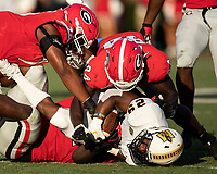 ATHENS, GA - SEPTEMBER 7: Michail Carter #76 and Walter Grant #84 help Netori Johnson #72 tackle running back MJ Fuller #29 during a game between Murray State Racers and University of Georgia Bulldogs at Sanford Stadium on September 7, 2019 in Athens, Georgia.