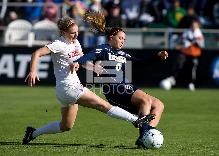 Annie Case (26) of Stanford tries to stop the shot of Melissa Henderson (6) of Notre Dame during the final of the NCAA Women's College Cup at WakeMed Soccer Park in Cary, NC.  Notre Dame defeated Stanford, 1-0.