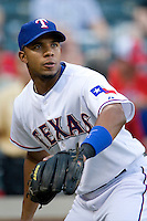 Texas Rangers shortstop Elvis Andrus #1 warms up before the Major League Baseball game against the Texas Rangers at the Rangers Ballpark in Arlington, Texas on July 27, 2011. Minnesota defeated Texas 7-2.  (Andrew Woolley/Four Seam Images)