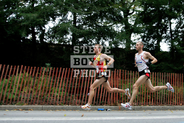 Brian Sell (left) and Jason Lehmkuhle run through Central Park while competing in the 2008 Men's Olympic Trials Marathon on November 3, 2007 in New York, New York.  The race began at 50th Street and Fifth Avenue and finished in Central Park.  Ryan Hall won the race with a time of 2:09:02.