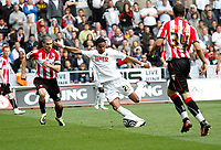 Npower Championship, Swansea City FC (white) V Sheffield United. Sat 7th May 2011 (12.45pm KO)<br /> Pictured:This shot from Scott Sinclar resulted in the penalty which put swansea two nil up<br /> Picture by: Ben Wyeth / Athena Picture Agency<br /> info@athena-pictures.com<br /> 07815 441513