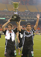 DC United midfielders Ben Olsen (14) and Jaime Moreno (99) lift the cup recognizing DC United as 2006 Atlantic Cup champions.  DC United defeated the New York Red Bulls 4-3. DC United earned a top seed in the 2006 MLS Playoffs and will enjoy home field advantage for the entire Eastern Conference Playoffs. Saturday, September 23, 2006, at RFK Stadium.