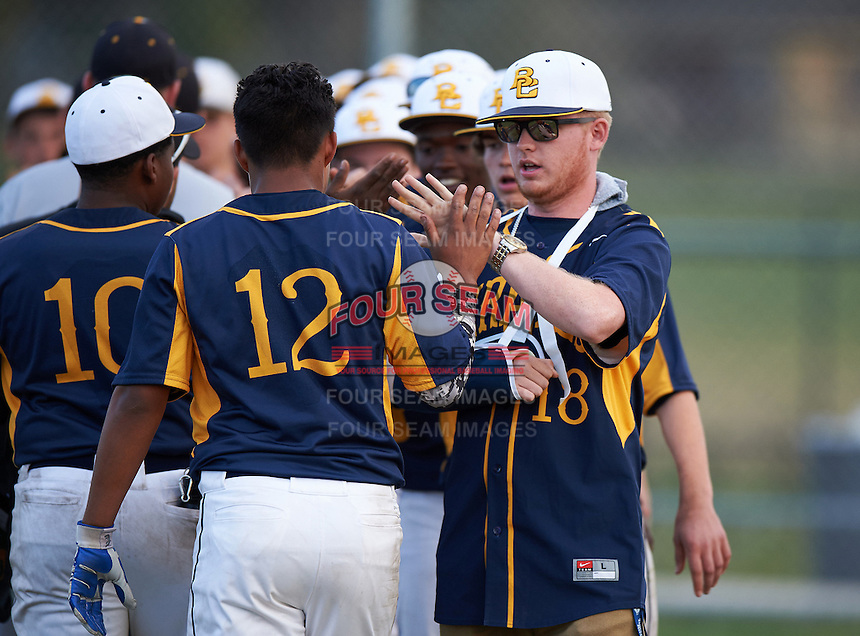 Boca Ciega Pirates Marlin Lagesse (18) high fives Ivan Rodriguez (12) after a game against the Lakeland Spartans at Boca Ciega High School on March 2, 2016 in St. Petersburg, Florida.  Boca Ciega defeated Lakewood 2-1.  (Mike Janes/Four Seam Images)