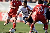 Charlie Davies dribbles between China's Zhang Yaokun (4) and Xu Yunlong (13). The USA defeated China, 4-1, in an international friendly at Spartan Stadium, San Jose, CA on June 2, 2007.
