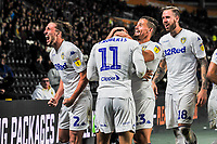 Leeds United's midfielder Kalvin Phillips (23) hugs goalscorer Leeds United's forward Tyler Roberts (11) during the Sky Bet Championship match between Hull City and Leeds United at the KC Stadium, Kingston upon Hull, England on 2 October 2018. Photo by Stephen Buckley/PRiME Media Images.